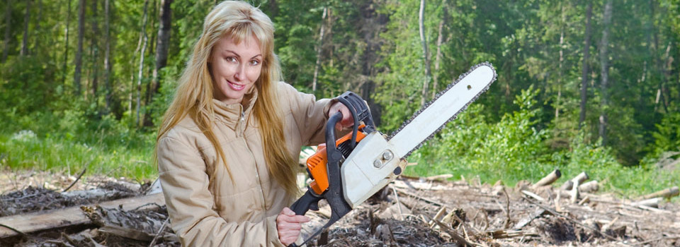 woman with chainsaw