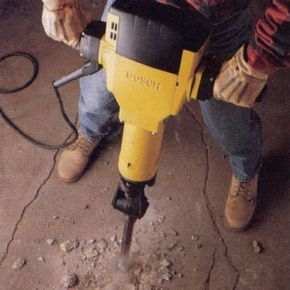 man using jack hammer